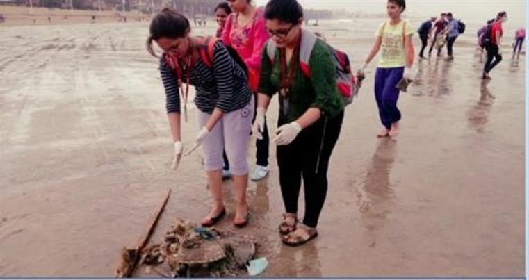 Beach cleaning activity after Ganpati visarjan done by the students of the Department