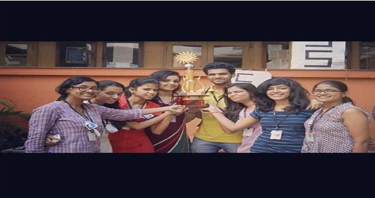Students with winner's trophy at Operon (Intercollegiate festival of SIES)